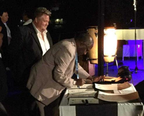 Richard Nilsson and Albert Konan Koffi signing